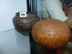 A SMALL COPPER VASE AND AN ENGRAVED GOURD.