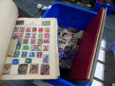 TWO STAMP ALBUMS, A STAMP CATALOGUE DATED 1975, AND A QUANTITY OF LOOSE STAMPS.