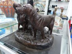 A CAST BRONZE FIGURE, TWO SPORTING DOGS BY TREE STUMP ON MARBLE PLINTH.