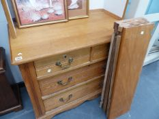 AN EDWARDIAN CHEST OF DRAWERS WITH LATER FITTED SHELVES.