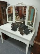 A PAINTED DRESSING TABLE WITH TRIPTYCHE MIRROR.