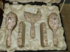 A SILVER MOUNTED DRESSING TABLE SET.
