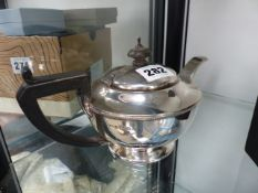 A SMALL HALLMARKED SILVER TEAPOT.