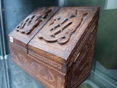 AN EASTERN HARDWOOD STATIONERY BOX WITH CARVED FRONT.