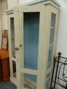 AN ANTIQUE PAINTED CABINET.