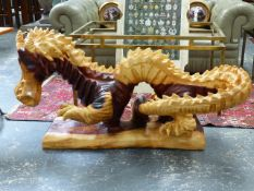 A LARGE EASTERN CARVED DRAGON.