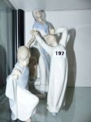 TWO LLADRO FIGURINES AND ONE OTHER.