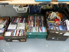 A LARGE QTY OF DVDS AND CDS.