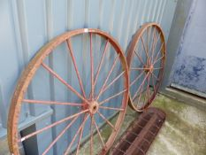 A PAIR OF CAST IRON WAGON WHEELS.