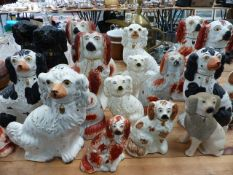 A LARGE COLLECTION OF VICTORIAN STAFFORDSHIRE SPANIELS.