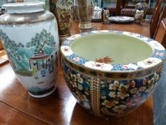 AN ORIENTAL FISH BOWL AND A VASE.