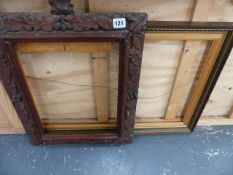 A CARVED OAK PICTURE FRAME AND ONE OTHER.