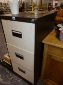 A FILING CABINET WITH KEY.