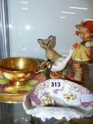 A SMALL DRESDEN BOWL, GOEBELS FIGURINE, A WADE CAT AND A COALPORT TRIO.