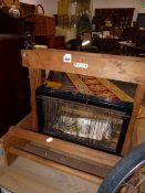 A VINTAGE TABLE LOOM.