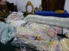 A LARGE COLLECTION OF VARIOUS CURTAINS AND TEXTILES.