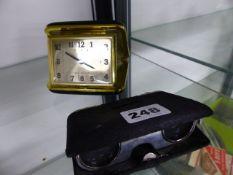AN ASPREY'S FOLDING OPERA GLASSES AND A TRAVEL CLOCK.