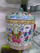 AN ORIENTAL POTTERY JAR AND COVER.
