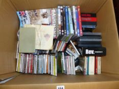 A BOX OF CDS AND DVDS.