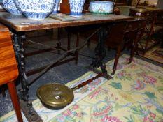A CAST IRON BASED PUB TABLE.