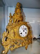 A VICTORIAN GILT MANTLE CLOCK.