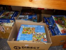 A LARGE QTY OF JIGSAW PUZZLES.