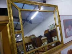 A LARGE GILT FRAMED MIRROR.