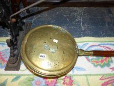 A VICTORIAN BRASS WARMING PAN.