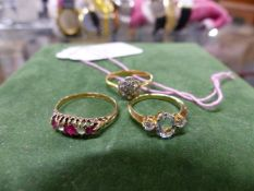 A 9ct GOLD AQUA MARINE RING, AN 18ct AND PLATINUM DIAMOND DAISY RING AND AN 18ct RUBY HALF HOOP