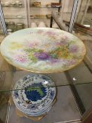 A LARGE HAND PAINTED POTTERY PLATTER TOGETHER WITH A SET OF EIGHT EASTERN DECORATED BOWLS SIGNED