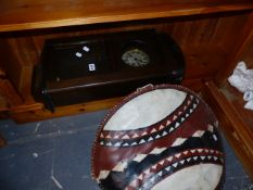 A YUNGANS WALL CLOCK AND AN AFRICAN SHIELD.