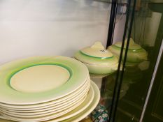 A CLARICE CLIFFE PART DINNER SERVICE.