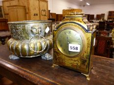 A CHINOISERIE DECORATED DESK CLOCK AND A DUTCH BRASS PLANTER.