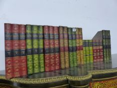 A GROUP OF FILING BOXES IN THE FORM OF BOOK SPINES.