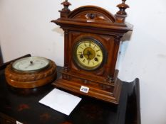 A VICTORIAN MANTLE CLOCK AND A BAROMETER.