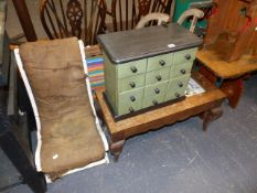 A NEST OF DRAWERS, NURSING CHAIR, SLEDGE, BOOKCASE AND A CHILD'S TABLE AND CHAIR.