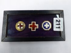 THREE CASED BADGES TO INCLUDE AN AMERICAN RED CROSS VOLUNTEER, A UNITED HOSPITAL FUND SERVICE AWARD,