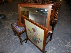 A VICTORIAN OAK FRAMED MIRROR, TWO CHAIRS AND A FIRESCREEN.