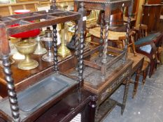 AN OAK STICKSTAND, A BIJOUTERIE CABINET AND A CARVED OAK FOLD OVER CARD TABLE.