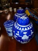 TWO BLUE AND WHITE GINGER JARS AND ONE OTHER.
