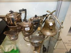 A SILVER PLATED FIVE PIECE TEASET AND A TABLE BELL.