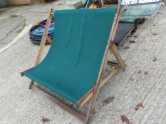 A LARGE DECK CHAIR.