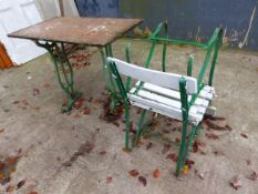 A MARBLE TOP GARDEN TABLE WITH PAINTED CAST IRON BASE TOGETHER WITH A PAIR OF SIMILAR CHAIRS.