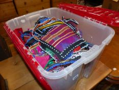 A LARGE QTY OF BEADED AND WOVEN TEXTILES,ETC.