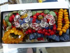 A COLLECTION OF NATURAL AND OTHER HARDSTONE BEADS.
