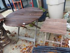 TWO FOLDING TEAK PATIO TABLES.