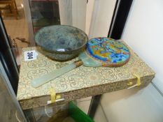 AN ORIENTAL BRONZE BOWL AND A HARDSTONE MOUNTED AND ENAMELLED MIRROR.