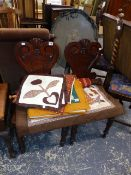 A PAIR OF VICTORIAN OAK HALL CHAIRS.