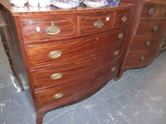 A REGENCY INLAID MAHOGANY BOW FRONT CHEST OF DRAWERS.