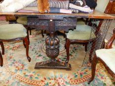 AN OAK DRAW LEAF REFECTORY TABLE.